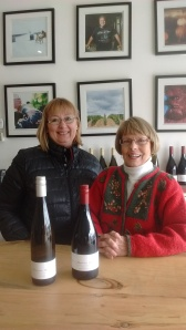 Jane Anderson receiving a donation of wine from Norman Hardie Winery & Vineyard.