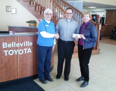 Laura Hare and Barbara Durnford receive $1000 donation from Andy Caletti, Owner and General Manager of Belleville Toyota